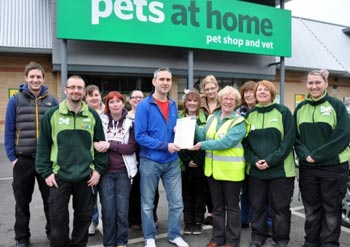Store manager Mike Southwick is pictured presenting the cheque for £904.19p to Sheila Lawson of Yorkshire Coast Dog Rescue